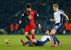 Ki Sung-Yueng of Swansea City is challenged by Claudio Yacob and Darren Fletcher of West Brom - Photo mandatory by-line: Rogan Thomson/JMP - 07966 386802 - 11/02/2015 - SPORT - FOOTBALL - West Bromwich, England - The Hawthorns - West Bromwich Albion v Swansea City - Barclays Premier League.