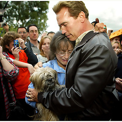 Claremont: Jana Miller of  the San Antonio Heights who lost everything she had except her dog &quot;Mugzy&quot; in the Grand Prix Fire cries in the arms of Govonor elect Arnold Schwarzenegger  after a press conference at the Alexander Hughes Community Center in Claremont,Calif., October 31,2003.<br /> (Pasadena Star-News Staff Photo Keith Birmingham/No Sales/Mags Out)