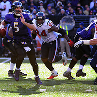 15 January 2012: Baltimore Ravens quarterback Joe Flacco (5) in action against Houston Texans defensive end Antonio Smith (94) and defensive end J.J. Watt (99) in the Divisional Playoff at M&T Bank Stadium in Baltimore, MD. The Ravens defeated the Texans 20-13 to advance to the AFC Championship game..