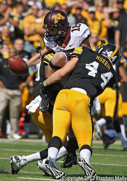 September 29 2012: Minnesota Golden Gophers wide receiver Derrick Engel (18) can't pull in a pass as he is hit by Iowa Hawkeyes linebacker Christian Kirksey (20) and linebacker James Morris (44) during the second quarter of the NCAA football game between the Minnesota Golden Gophers and the Iowa Hawkeyes at Kinnick Stadium in Iowa City, Iowa on Saturday September 29, 2012. Iowa defeated Minnesota 31-13 to claim the Floyd of Rosedale Trophy.