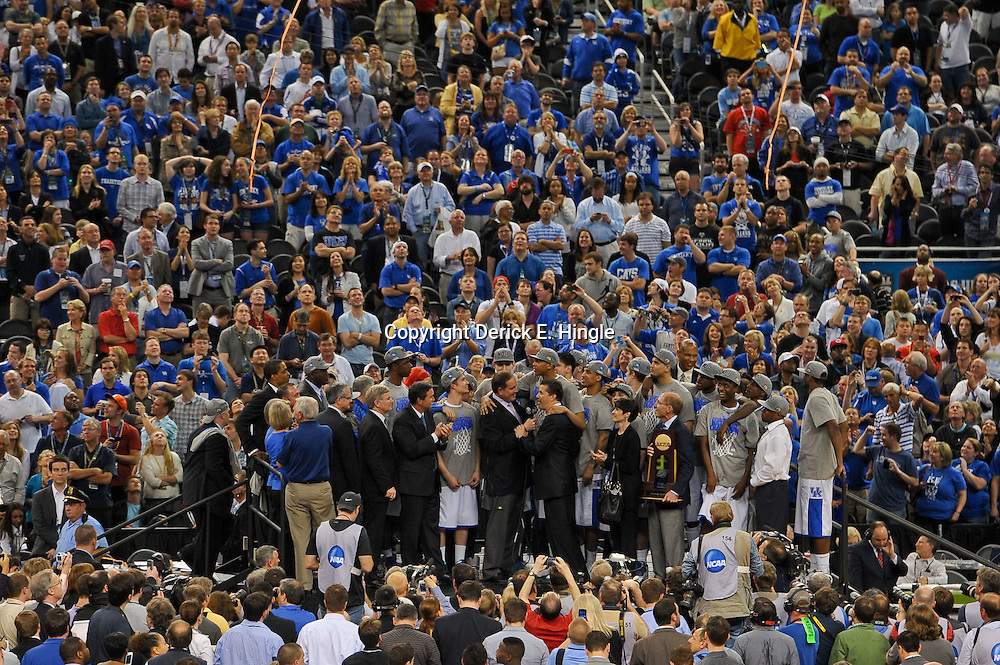Apr 2, 2012; New Orleans, LA, USA; A general view as Kentucky Wildcats head coach John Calipari is presented with the NCAA National Championship trophy after defeating the Kansas Jayhawks 67-59 in the finals of the 2012 NCAA men's basketball Final Four at the Mercedes-Benz Superdome. Mandatory Credit: Derick E. Hingle-US PRESSWIRE