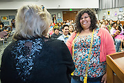 An unidentified student receives a Gold Cord for completing more than 90 hours of community service during the school year during the Calaveras Hills High School Awards Night & Art Show at Calaveras Hills High School in Milpitas, California, on May 7, 2014. (Stan Olszewski/SOSKIphoto)