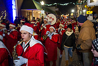 """Laconia High School marching band brought the sounds of the season down Main Street during the """"Light Up Laconia"""" Holiday Parade Sunday evening.  (Karen Bobotas/for the Laconia Daily Sun)"""