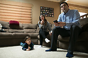 Victor Padilla, 3, watches television with his parents Jenny and Jerry at their home in Rochester, New York on Monday, March 6, 2017.