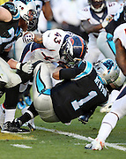 Denver Broncos strong safety T.J. Ward (43) hits Carolina Panthers quarterback Cam Newton (1) with the crown of his helmet resulting in an unnecessary roughness penalty on the Broncos that gives the Panthers the a first down at their own 45 yard line in the first quarter during the NFL Super Bowl 50 football game against the Carolina Panthers on Sunday, Feb. 7, 2016 in Santa Clara, Calif. The Broncos won the game 24-10. (©Paul Anthony Spinelli)