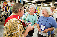 The Rev. Frederick Reinhardt, LCMS area facilitator for French-speaking Central, East and West Africa, chats with Charla Wolff (center) and Marilyn Winter during the 36th Biennial Convention of the Lutheran Women's Missionary League on Friday, June 26, 2015, at the Iowa Events Center in Des Moines, Iowa. LCMS Communications/Erik M. Lunsford