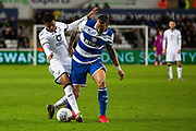 Swansea City forward Rhian Brewster (19) and Queens Park Rangers defender Geoff Cameron (5) during the EFL Sky Bet Championship match between Swansea City and Queens Park Rangers at the Liberty Stadium, Swansea, Wales on 11 February 2020.
