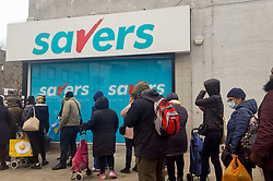 © Licensed to London News Pictures. 13/03/2020. London, UK. A shopper wearing a surgical mask queues outside <br /> Savers in North London for toilet rolls as panic-buying in supermarkets continues amid an increased number of Coronavirus (COVID-19) cases in the UK. Major supermarkets have started to ration certain products after shoppers began to stockpile. 590 cases have been tested positive and ten patients have died from the virus in the UK.. Photo credit: Dinendra Haria/LNP