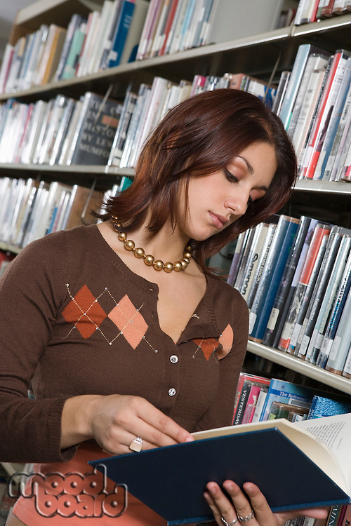 Female University student studying in library