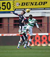 Dundee&rsquo;s Craig Wighton oujumps Celtic&rsquo;s Eboue Kouassi - Dundee v Celtic in the Ladbrokes Scottish Premiership at Dens Park, Dundee.Photo: David Young<br /> <br />  - &copy; David Young - www.davidyoungphoto.co.uk - email: davidyoungphoto@gmail.com