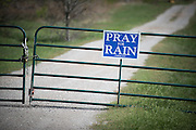 A sign encouraging passers by to pray for rain is attached to a ranch gate on Highway 1954 just south of Wichita Falls, Texas where the area is dealing with severe drought conditions.