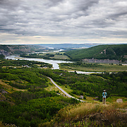 A woman looks out over the Peace River in Ft St John, British Columbia.