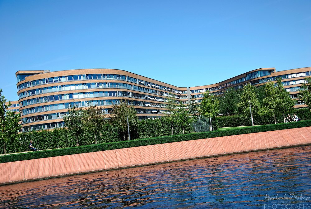 A curved office building as viewed from the Spree River in Berlin, Germany.