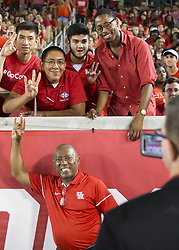 September 16, 2017 - Houston, TX, USA - Houston Mayor Sylvester Turner poses for photos with a group of Houston Cougars cheerleaders during halftime of the college football game between the Houston Cougars and the Rice Owls at TDECU Stadium in Houston, Texas. (Credit Image: © Scott W. Coleman via ZUMA Wire)