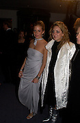 Sienna Miller and Natasha Corrett, Cold Mountain premiere after-party. Royal Opera House, 14 December 2003. © Copyright Photograph by Dafydd Jones 66 Stockwell Park Rd. London SW9 0DA Tel 020 7733 0108 www.dafjones.com