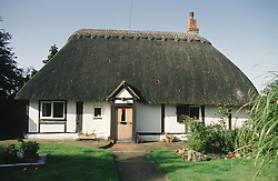 Cottage with thatched roof,