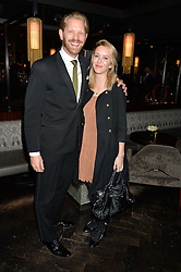 ALISTAIR GUY and ALEXANDRA BERG at the OMEGA VIP dinner hosted by Cindy Crawford and OMEGA President Mr. Stephen Urquhart held at aqua shard', Level 31, The Shard, 31 St Thomas Street, London, SE1 9RY on 10th December 2014.