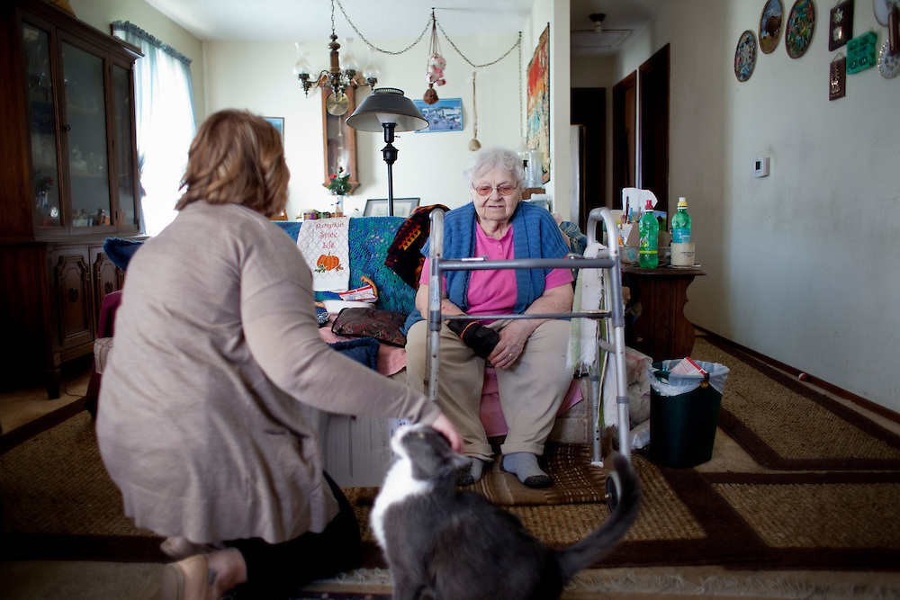 Louise Niedermayer talks with Horizons volunteer coordinator Anna Ronnebaum at her home in Cedar Rapids, Iowa on Thursday, November 19, 2015. Niedermayer lives alone with her cat, Snoopy, and receives a Meals on Wheels delivery daily from one of the volunteers at Horizons. (Rebecca F. Miller/Freelance for The Gazette)