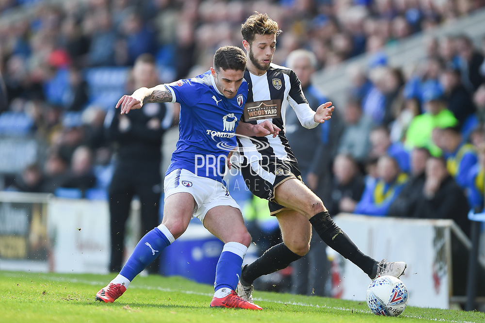 Chesterfield defender Bradley Barry (27) battles with Notts County midfielder Jorge Grant (10) during the EFL Sky Bet League 2 match between Chesterfield and Notts County at the b2net stadium, Chesterfield, England on 25 March 2018. Picture by Jon Hobley.