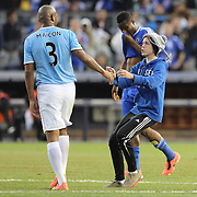 A fan runs onto the field at the end of the game and confronts Maicon Sisenando, Manchester City, during the Manchester City V Chelsea friendly exhibition match at Yankee Stadium, The Bronx, New York. Manchester City won the match 5-3. New York. USA. 25th May 2012. Photo Tim Clayton
