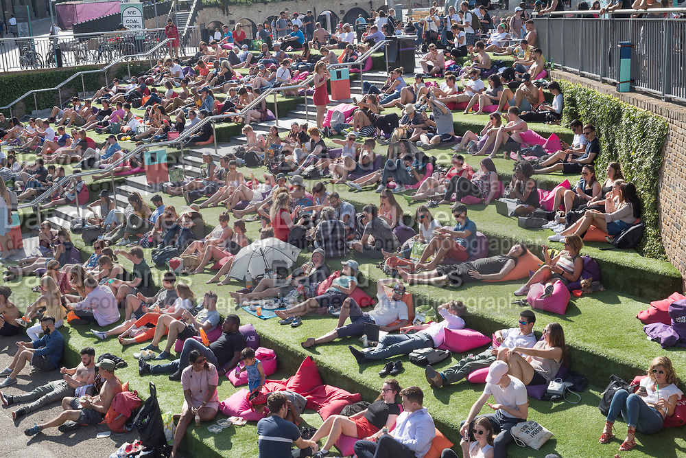 Watching films By the canal. King's Cross. 4 July 2019