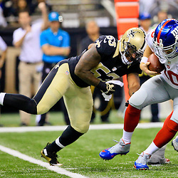 Nov 1, 2015; New Orleans, LA, USA; New York Giants quarterback Eli Manning (10) is sacked by New Orleans Saints inside linebacker Ramon Humber (53) during the first quarter of a game at the Mercedes-Benz Superdome. Mandatory Credit: Derick E. Hingle-USA TODAY Sports