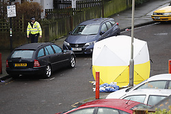 © Licensed to London News Pictures. 06/02/2019. London, UK. Police keep guard at the crime scene on Westbridge Road in Battersea where a 19 year old man was fatally stabbed last night. Police have arrested two men. Photo credit: Peter Macdiarmid/LNP