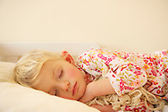 Two year old girl blissfully asleep.<br />