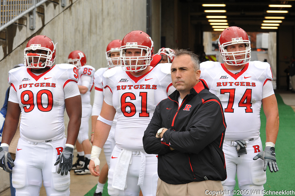 Oct 31, 2009; East Hartford, CT, USA; Rutgers co-offensive coordinator Kyle Flood and linemen Michael Larrow (90), Ryan Blaszczyk (61) and Howard Barbieri (74) wait to take the field for first half Big East NCAA football action between Rutgers and Connecticut at Rentschler Field.