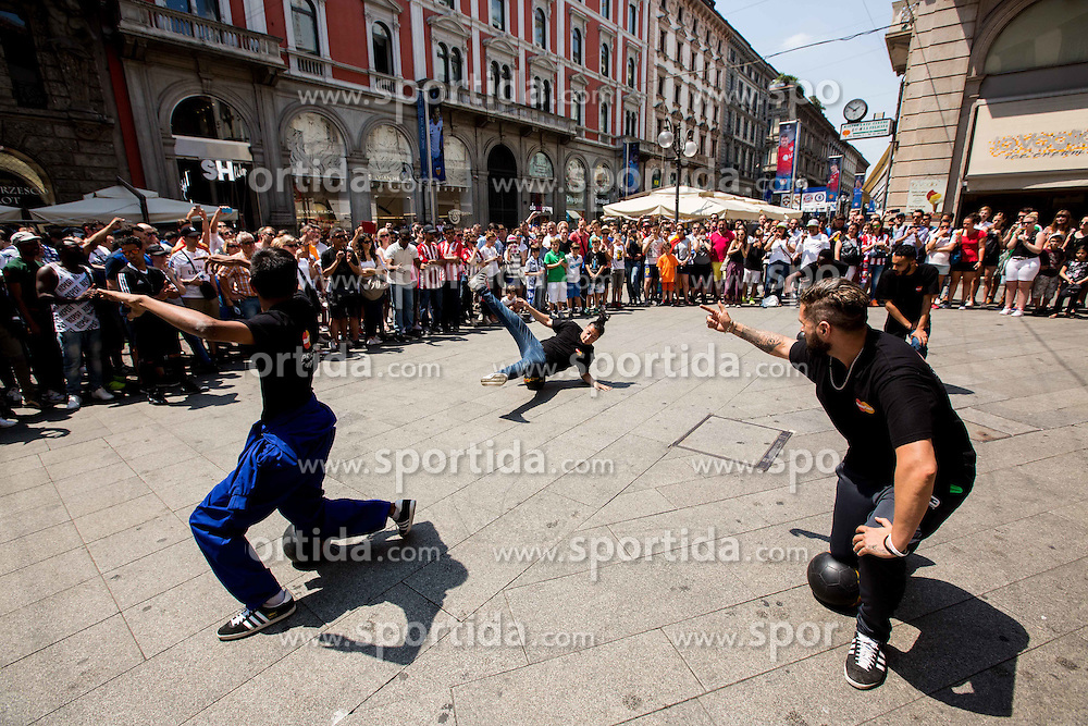 Juggling performers  in the city centre prior to the football match between Real Madrid (ESP) and Atlético Madrid (ESP) in Final of UEFA Champions League, on May 28, 2016 in Doumo, Milan, Italy. Photo by Vid Ponikvar / Sportida