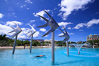 The giant fish sculptures and aqua blue waters of the Esplanade Lagoon on the foreshore at Cairns