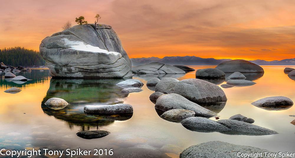 Bonsai Rock Sunset 3 - A panoramic photograph of a winter sunset over Lake Tahoe at Bonsai Rock
