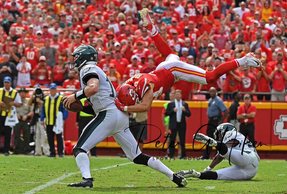 Defensive back Daniel Sorensen #49 of the Kansas City Chiefs leaps to make a sack attempt on quarterback Carson Wentz #11 of the Philadelphia Eagles during the fourth quarter of the game at Arrowhead Stadium in Kansas City, Missouri.