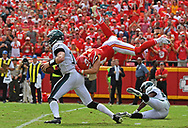 Defensive back Daniel Sorensen #49 of the Kansas City Chiefs leaps to make a sack attempt on quarterback Carson Wentz #11 of the Philadelphia Eagles during the fourth quarter of the game at Arrowhead Stadium in Kansas City, Missouri.