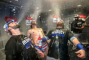 Los Angeles Dodgers Josh Reddick (C) and teammates spit beer into the air as they celebrate winning the National League Division Series against the Washington Nationals at Nationals Park in Washington, D.C. on October 13, 2016. The Dodgers defeated the Nationals 4-3 in game 5.