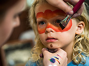 27 JUNE 2019 - CENTRAL CITY, IOWA: ZEPHY ATKINS, 6, gets his face painted at the Linn County Fair. Summer is county fair season in Iowa. Most of Iowa's 99 counties host their county fairs before the Iowa State Fair, August 8-18 this year. The Linn County Fair runs June 26 - 30. The first county fair in Linn County was in 1855. The fair provides opportunities for 4-H members, FFA members and the youth of Linn County to showcase their accomplishments and talents and provide activities, entertainment and learning opportunities to the diverse citizens of Linn County and guests.      PHOTO BY JACK KURTZ