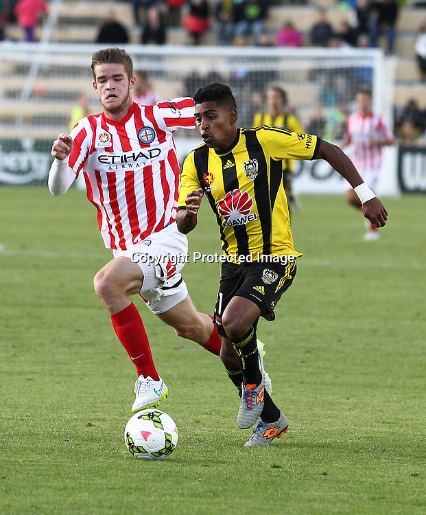 Phoenix' Roy Krishna makes a break during the A-League football match between the Wellington Phoenix & Melbourne City, at the Hutt Recreational Ground, Wellington, 14 February 2015. Photo.: Grant Down / www.photosport.co.nz