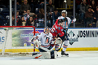 KELOWNA, BC - MARCH 09: Dylan Garand #30 defends the net as Montana Onyebuchi #5 of the Kamloops Blazers checks Liam Kindree #26 of the Kelowna Rockets  at Prospera Place on March 9, 2019 in Kelowna, Canada. (Photo by Marissa Baecker/Getty Images)
