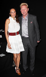 Boris Becker and his wife at the Carolina Herrera show  at  New York Fashion Week, Monday, 10th  September 2012. Photo by: Stephen Lock / i-Images