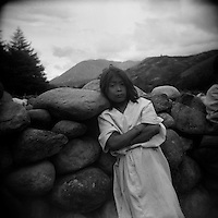 A young Arahuaco Indian boy leans on a stone wall in Nabusimake, an important Indian village to the Arahuaco tribe in the Sierra Nevada mountains of Colombia in 2003. (Photo/Scott Dalton)