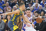 January 31, 2019; Oakland, CA, USA; Philadelphia 76ers guard JJ Redick (17) dribbles the basketball against Golden State Warriors guard Stephen Curry (30) during the first quarter at Oracle Arena.