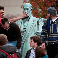 "November 19, 2009 - Lexington, Kentucky, USA - University of Kentucky sophomore LOGAN BAILEY held his cigarette to the mouth of a statue of UK's first president, JAMES PATTERSON, while being watched by fellow sophomore ADAM KIDD, right, as they and other students have a ""smoke-out"" to protest the University's tobacco ban on campus which began today. About a hundred student smokers and non-smokers gathered to protest the campus-wide tobacco ban UK implemented Thursday by continuously using tobacco products in front of Patterson Office Tower and on the Student Center patio. The ban prohibits the use of cigarettes, pipes, cigars and chewing tobacco, and extends to all properties owned by the university in Fayette County. (Credit image: © David Stephenson/ZUMA Press)"