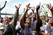 New Orleans, Louisiana. United States. February 28th 2006..People ask for beads and presents at the Zulu Parade on Lee Circle.