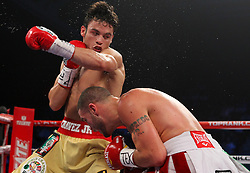 November 19, 2011; Houston, TX; USA; Julio Cesar Chavez Jr. (gold trunks) and Peter Manfredo (white trunks) during their 12 round bout at the Reliant Arena.