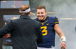 Dec 3, 2016; Morgantown, WV, USA; West Virginia Mountaineers quarterback Skyler Howard (3) with West Virginia Mountaineers head coach Dana Holgorsen during senior day ceremonies before their game against the Baylor Bears at Milan Puskar Stadium. Mandatory Credit: Ben Queen-USA TODAY Sports