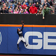 NEW YORK, NEW YORK - MAY 04:  Mallex Smith #17 of the Atlanta Braves can't stop a first home run for Lucas Duda #21 of the New York Mets during the Atlanta Braves Vs New York Mets MLB regular season game at Citi Field on May 04, 2016 in New York City. (Photo by Tim Clayton/Corbis via Getty Images)