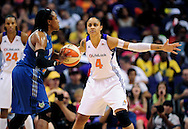 Sep 11, 2011; Phoenix, AZ, USA; Phoenix Mercury forward .Candice Dupree (4) guards Minnesota Lynx guard Alexis Hornbuckle (14) during the second half at the US Airways Center.  The Lynx defeated the Mercury 96-90. Mandatory Credit: Jennifer Stewart-US PRESSWIRE