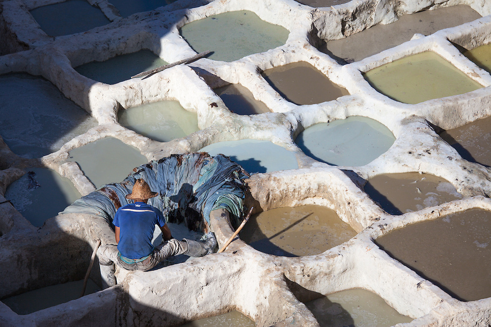 A worker at the famous tanneries of Fez, central Morocco, early in the morning.