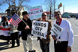 "4/6/2014 Allentown, PA. Nazih ""Nick"" Zarif Mouhrez of Catasauqua (center) holds a protest sign. PA Members of the Lehigh Valley Syrian community gather at the corner of Airport Road and Union Boulevard in Allentown to protest against supporting terrorist groups in Syria. Photo 