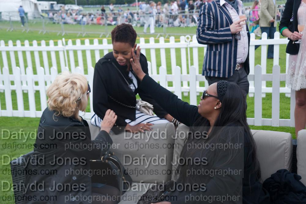 Amanda Eliasch; Tolula Adeyemi; Cartier International Polo Day at the Guards Polo Club. Windsor. July 26  2009